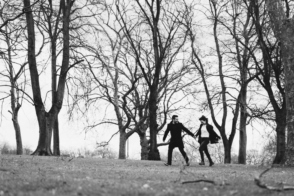 Engagement shoot couple run across a super windy park!