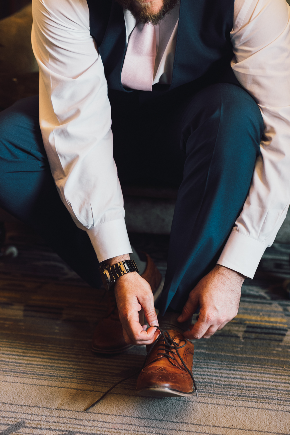 Groom laces up shoes