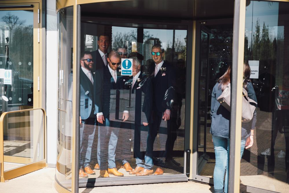 Groomsmen stuck in revolving door before wedding
