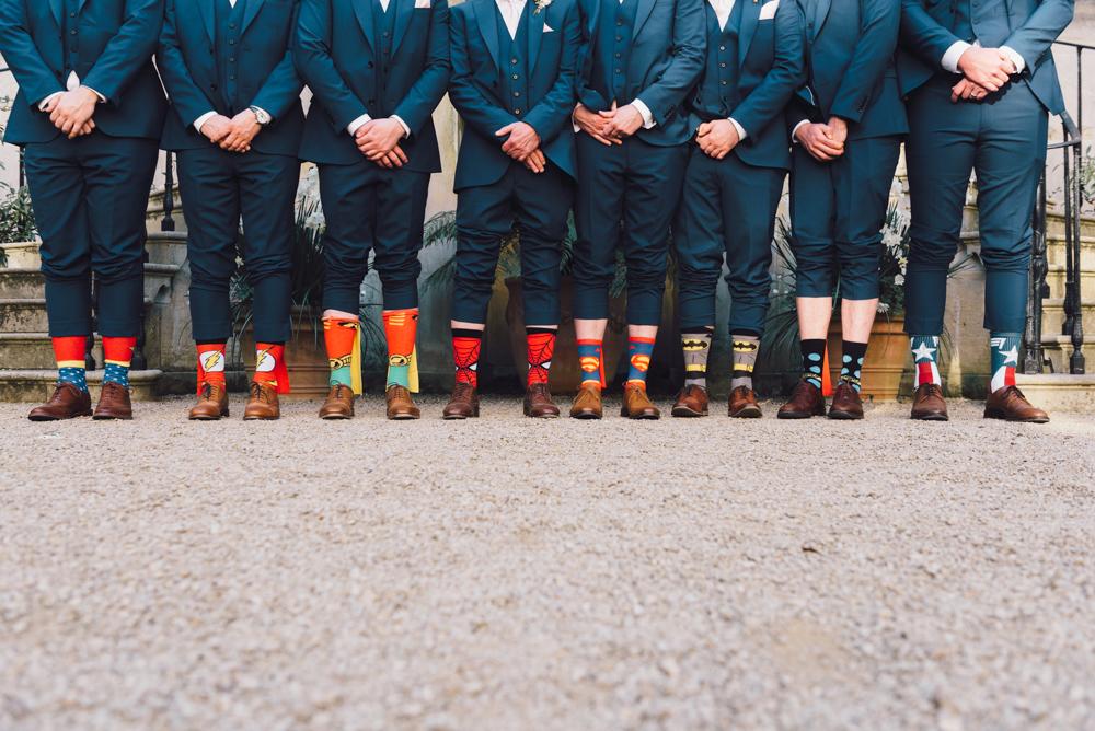 Groomsmen wear superhero socks to the wedding