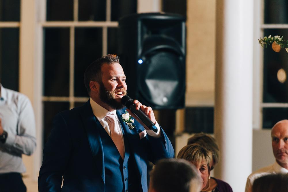 Best man gives speech at wedding