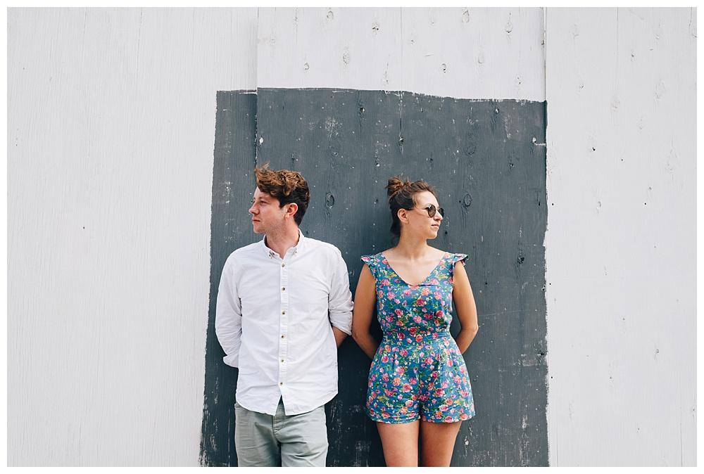 Couple framed by graffiti-covered hoarding