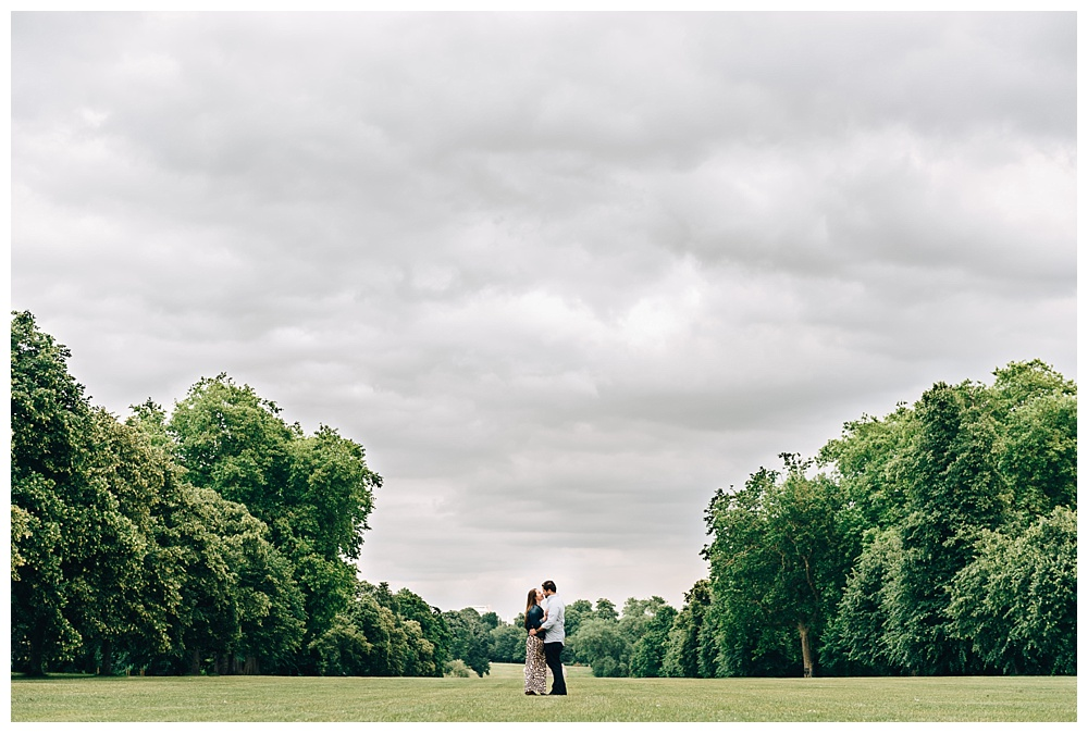 Happy newly engaged couple after proposal in London park