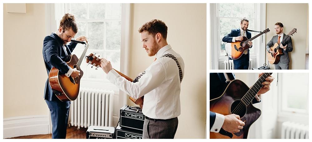 Guitarists prepare before the wedding ceremony