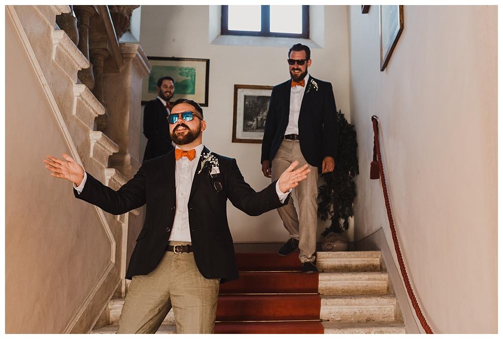 Groomsmen come downstairs at Villa Catignano wedding