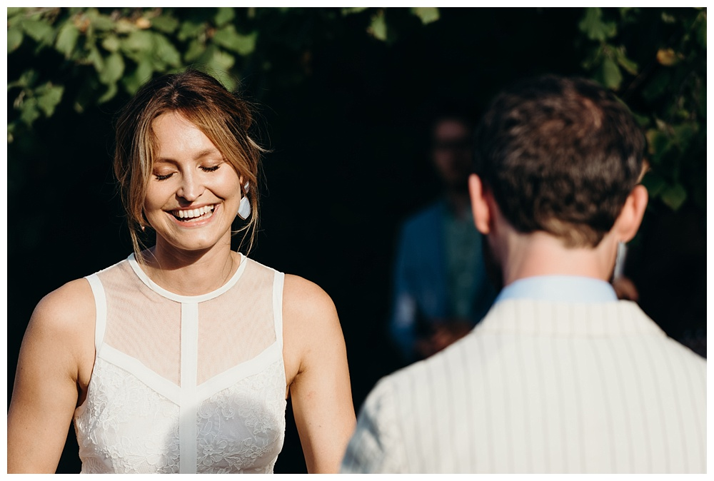 Bride smiles during vows