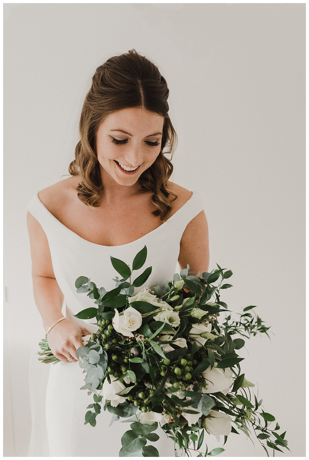Bride in wedding dress with bouquet.
