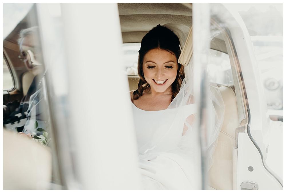 Bride in car on way to wedding.
