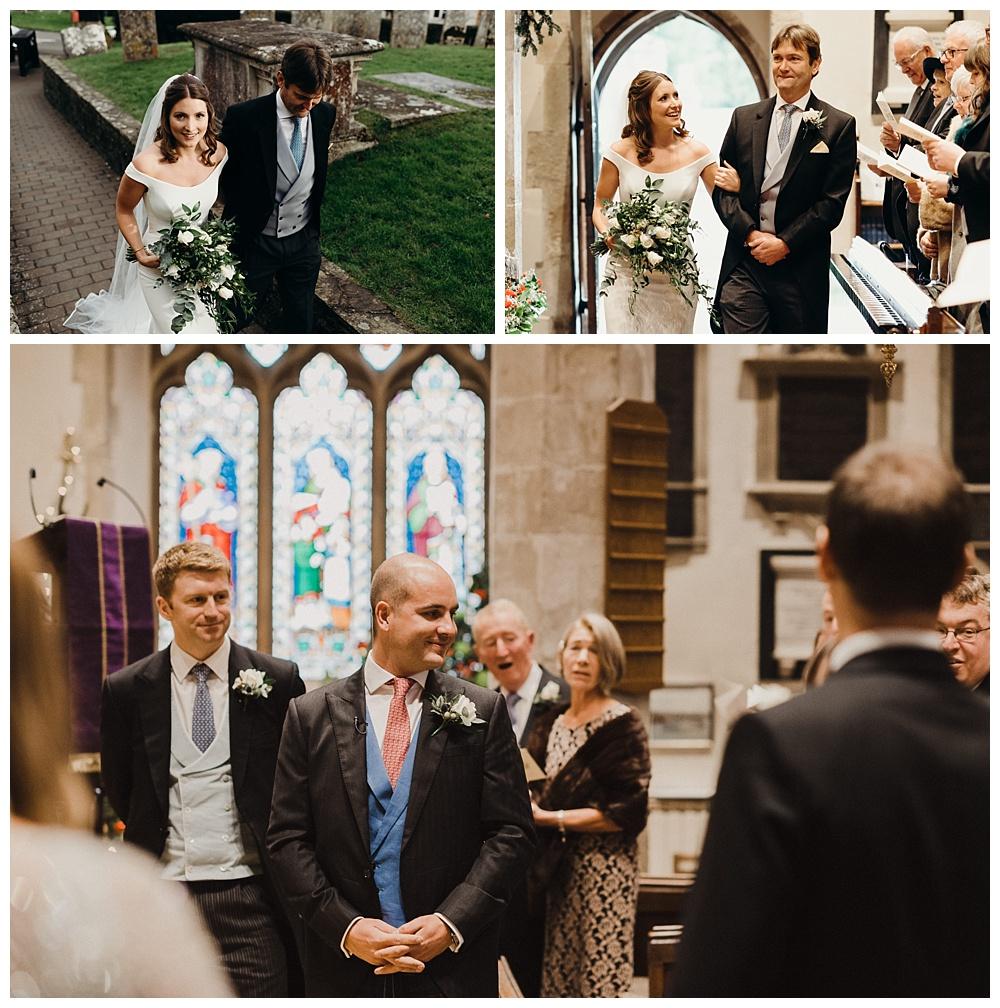 Groom sees bride walking down the aisle.